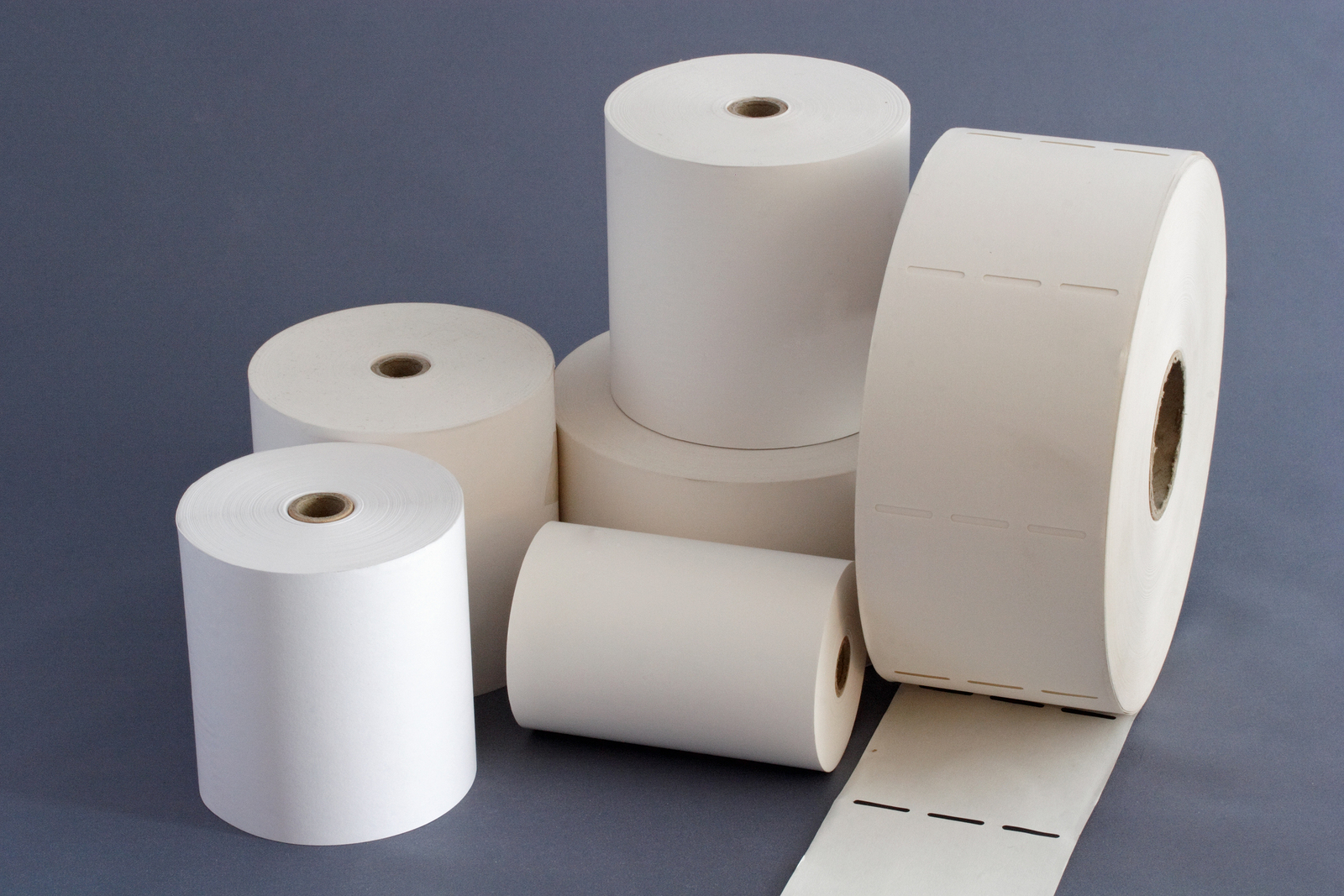Composition of six white paper rolls with paper core for cash Register and Calling system